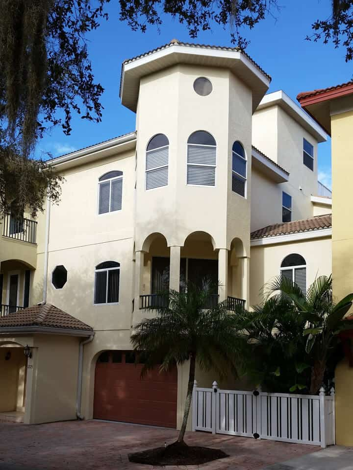 exterior painted cream tower house